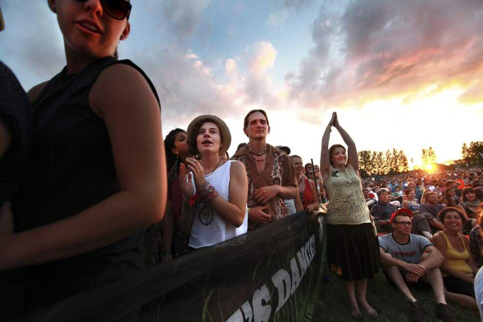 The crowd cheers on Feist as she performs on the Main Stage at the 39th annual Winnipeg Folk Festival at Birds Hill Park Wednesday, July 04, 2012. (RUTH BONNEVILLE / WINNIPEG FREE PRESS)