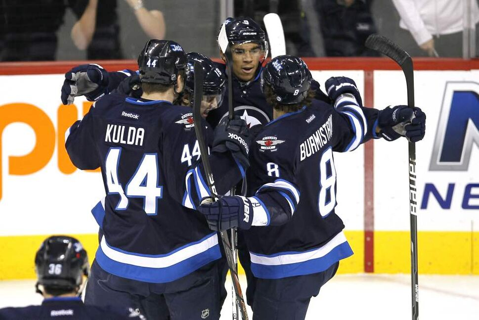 Winnipeg Jets forward Evander Kane (9) celebrates his goal against the Washington Capitals with defenceman Artus Kulda (44) forward Bryan Little (18) and forward Alexander Burmistrov (8) during first period NHL action in Winnipeg on November 17, 2011. (John Woods / WINNIPEG FREE PRESS)