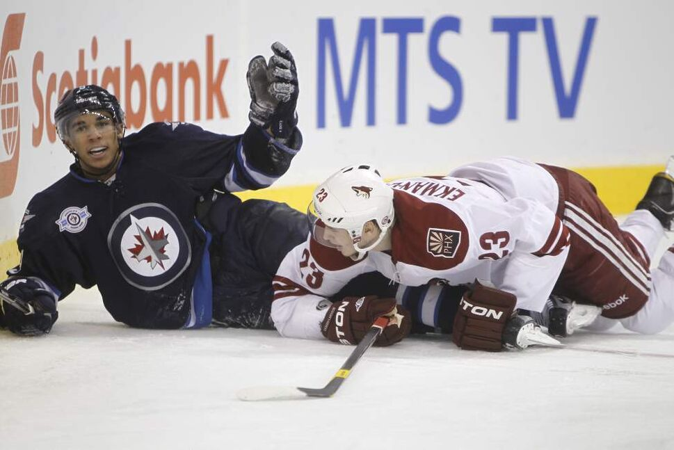 Winnipeg Jets' Evander Kane (9) looks for a penalty after being dragged down by Phoenix Coyotes' Oliver Ekman-Larsson (23) during the second period of play at MTS Centre, December 1st, 2011. (TREVOR HAGAN/WINNIPEG FREE PRESS)
