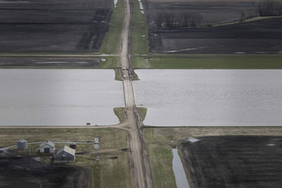 Water from the Portage Diversion just flows under the HWY 227 bridge. May 12, 2011. (Mike Deal / Winnipeg Free Press)