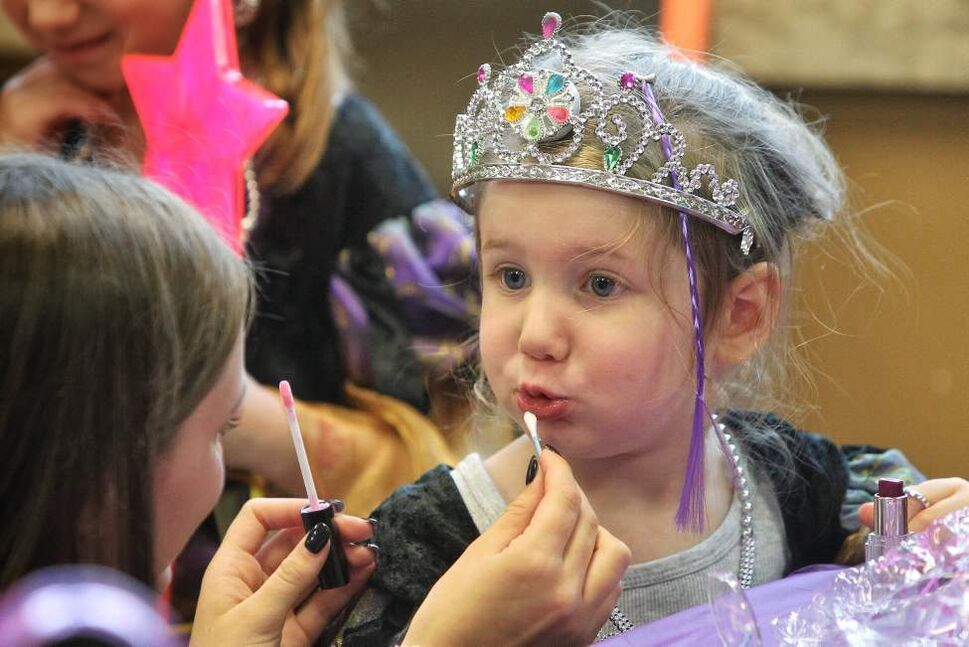 Bailee Shur, 3, has lipgloss applied during the Princess for a Day fundraising event at the Canadian Mennonite University. Around 60 little girls, including five who are battling life-threatening illnesses, are taking part in a unique fundraising event for the Children's Wish Foundation Manitoba and Nunavut.  October 26, 2014  (Mike Deal / Winnipeg Free Press)