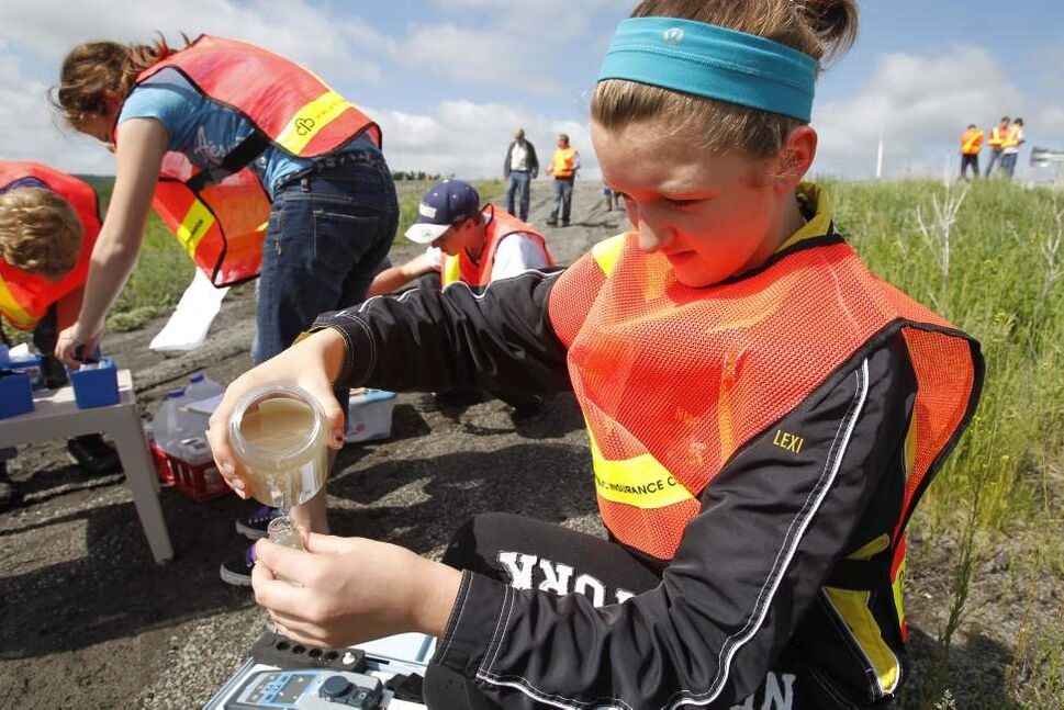 Lexi Hacault, a student from Nellie McClung Collegiate, participates in the River Watch program where they test water samples from various rivers in south western Manitoba. June 16, 2011