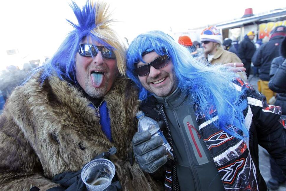 Randy Giesbrecht and Paul Reid are two of the 30,051 fans at Canad Inns Stadium to watch the Bombers take on the Hamilton Tiger-Cats in the Eastern final. November 20, 2011