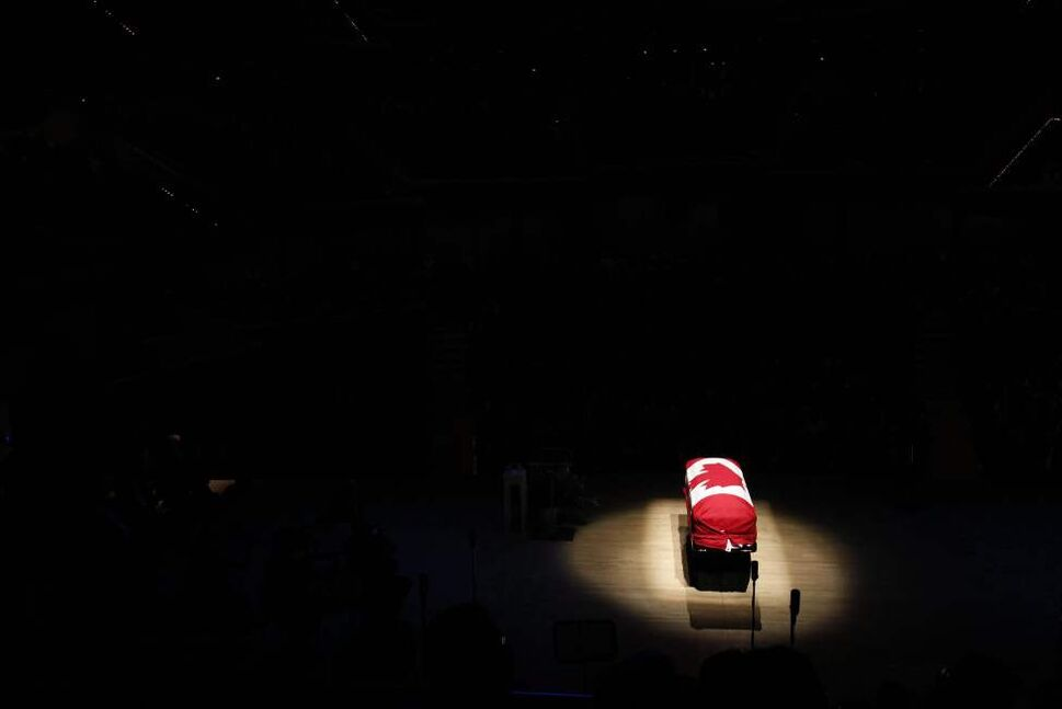 The coffin of the late NDP Leader Jack Layton sits under a spotlight during his state funeral at Roy Thomson Hall in Toronto on Saturday, August 27, 2011. THE CANADIAN PRESS/Frank Gunn