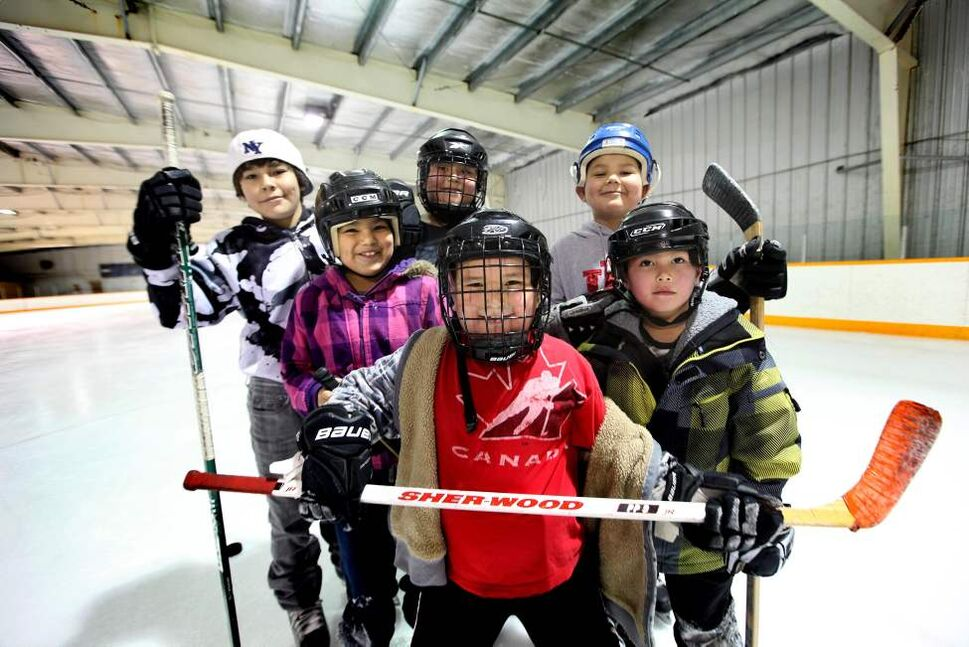 A group of elementary kids smile as they stop for a quick photo while hitting the ice at Ebb and Flow arena after school.  January 25, 2012 (Ruth Bonneville /  Winnipeg Free Press)