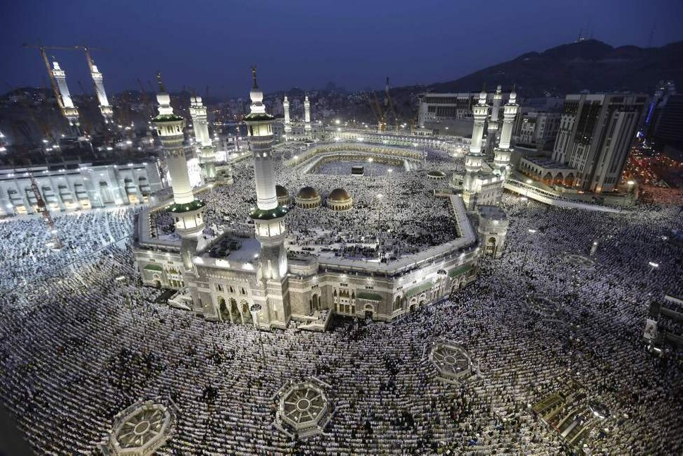 Muslim pilgrims circle the Kaaba as pray inside and outside the Grand mosque in Mecca, Saudi Arabia, Monday, Oct. 22, 2012. The annual Islamic pilgrimage draws three million visitors each year, making it the largest yearly gathering of people in the world. (AP Photo/Hassan Ammar)