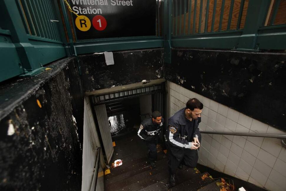 NYPD officers inspect a flooded subway station in lower Manhattan, Tuesday, October 30, 2012. All subway and train service has been cancelled as Hurricane Sandy caused major damage to New York City and surrounding areas. (Carolyn Cole/Los Angeles Times/MCT)