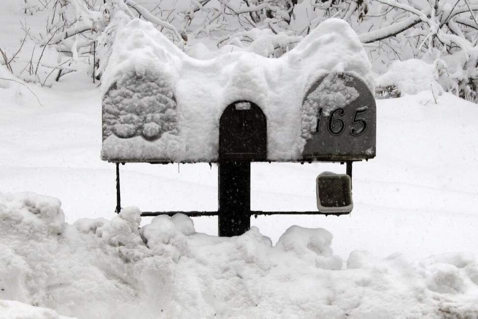Snow from superstorm Sandy is piled on mailboxes in Champion, Pa., Tuesday, Oct. 30, 2012. Pennsylvania was battered by strong wind and heavy rain but escaped major flooding as a weakened Sandy churned across the state Tuesday, plunging more than a million customers into darkness and leaving a trail of damage that included shorn roofs, toppled trees and crushed cars (AP Photo/Gene J. Puskar)