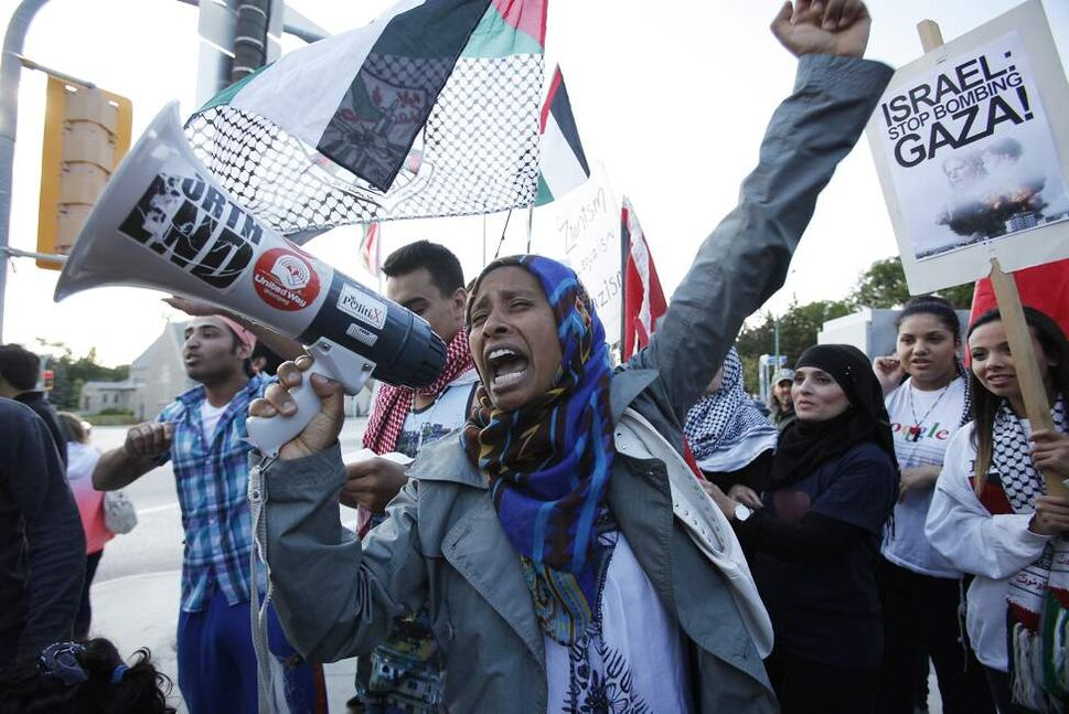 Palestinian supporters hold a rally at the Manitoba Legislative Building. July 14, 2014.  This image is from a rally against the Israel bombing of Gaza. It reminds me of the freedom we still have in this country to gather freely, unlike those who live under unjust regimes and occupation. — John Woods     (John Woods/Winnipeg Free Press)
