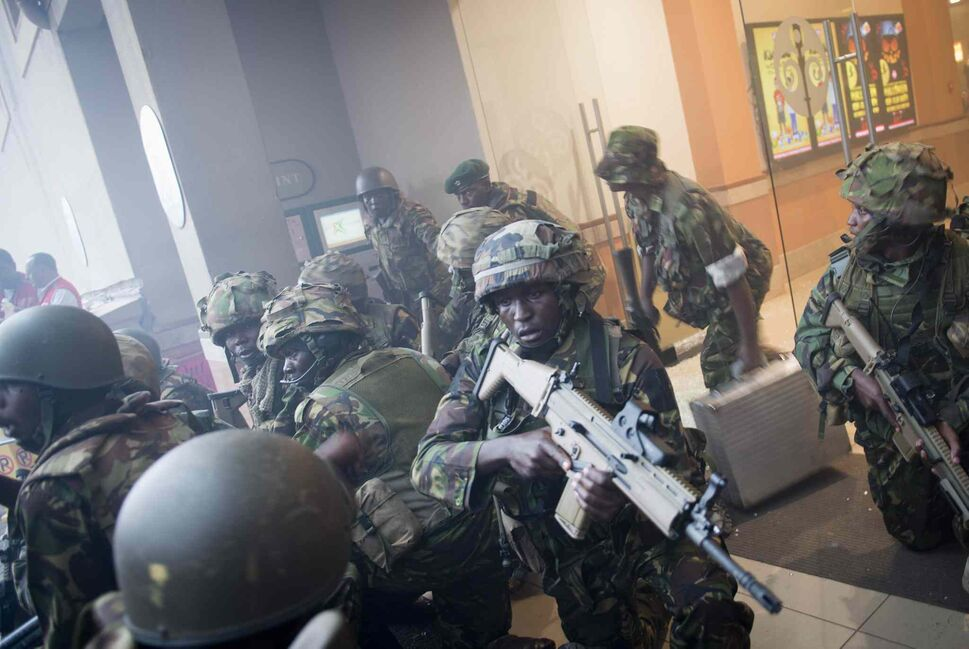 Armed police leave after entering the Westgate Mall in Nairobi, Kenya Saturday, Sept. 21, 2013. Gunmen threw grenades and opened fire Saturday, killing at least 22 people in an attack targeting non-Muslims at an upscale mall in Kenya's capital that was hosting a children's day event. (Jonathan Kalan / The Associated Press)