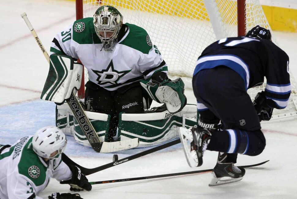 Michael Frolik gets a shot on Dallas Stars goaltender Dan Ellis during the third period. (JOE BRYKSA / WINNIPEG FREE PRESS)