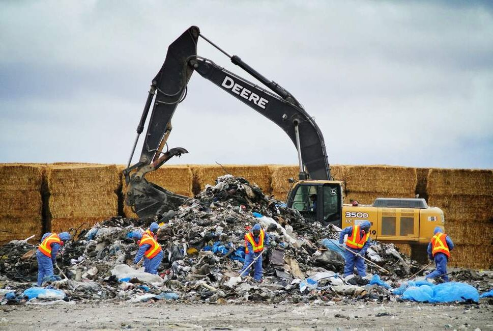 Winnipeg Police officers sift through debris at the Brady Road Landfill looking for the remains of Tanya Nepinak. Nepinak, 31, has been missing since September 2011 and her remains have never been found. Police believe they may be buried somewhere in the city landfill and that she was killed by alleged serial killer Shawn Lamb. Wednesday, October 03, 2012.  (MIKE DEAL / WINNIPEG FREE PRESS)