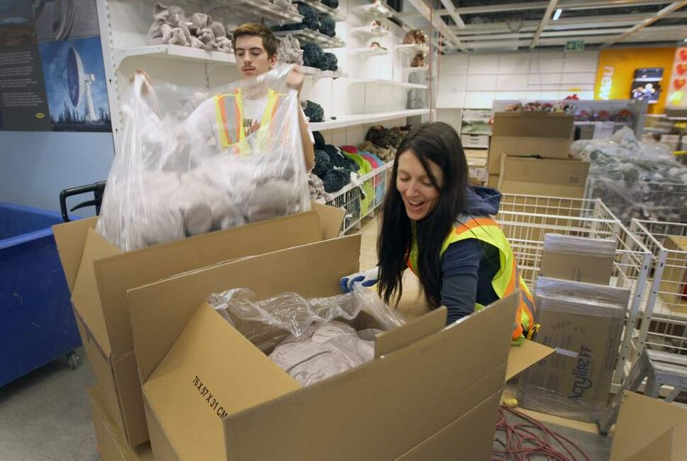 Workers unpack product in the Ikea kids area on the showroom level of the new Ikea Winnipeg Wednesday.  (JOE BRYKSA / WINNIPEG FREE PRESS)