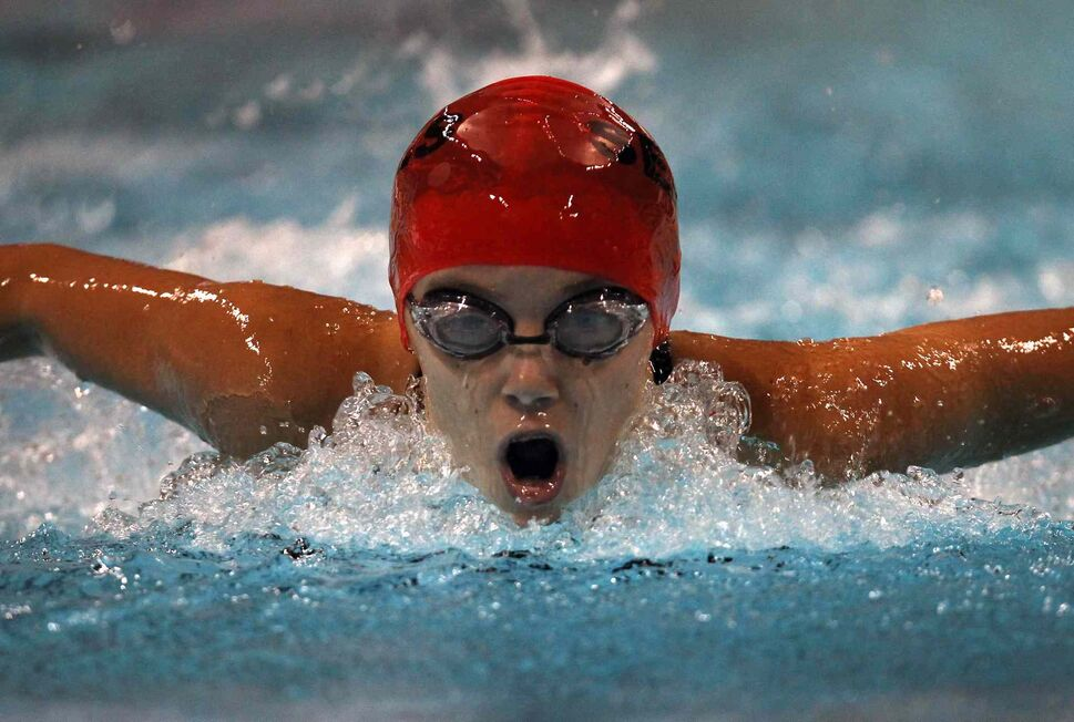 Sarah Watson of the St James Seals  emerges from the water during her 13 yearr old girls' 200m Fly at the 2014 Canadian Age Group Championships at Pan Am Pool in Winnipeg. (JOE BRYKSA / WINNIPEG FREE PRESS)