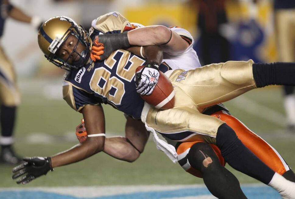 BC Lions Jason Arakgi hauls down Winnipeg Blue Bombers Terrence Edwards  during fourth quarter during CFL action at Canad Inns Stadium Friday night - BC won over the Winnipeg Blue Bombers 20-17 with 1 second left after kicking a field goal. 
