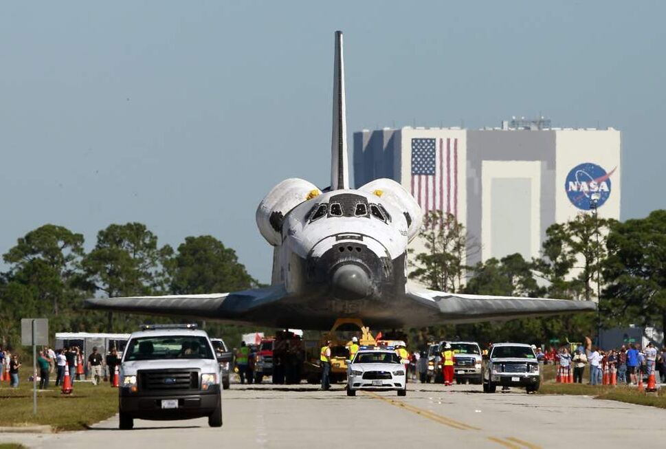 Space shuttle Atlantis make its way from the Vehicle Assembly Building to the Visitor Complex at the Kennedy Space Center, Friday, Nov. 2, 2012, in Cape Canaveral, Fla. Atlantis will be on display at the Visitor Complex in July, 2013.(AP Photo/John Raoux)