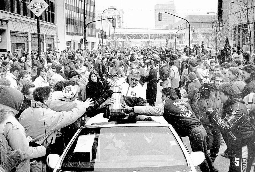 Bombers president Ross Brown holds the Grey Cup during a victory parade down Portage Avenue in 1988. (WINNIPEG FREE PRESS ARCHIVES)