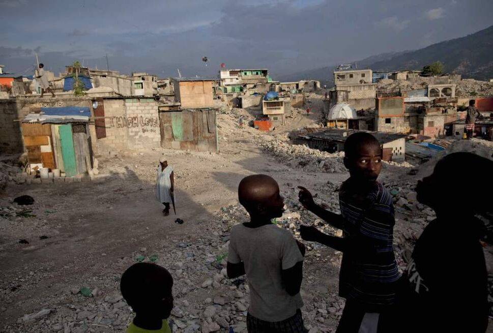 Children flight a kite in an area damaged by Jan. 12 earthquake in Fort Nationale neighborhood, Port-au-Prince, Haiti, Saturday, Sept. 4, 2010.  (Ramon Espinosa / The Associated Press)