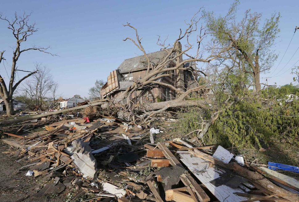 A home is covered by debris from a tornado in Baxter Springs, Kan., Monday, April 28, 2014.  (Orlin Wagner / The Associated Press)