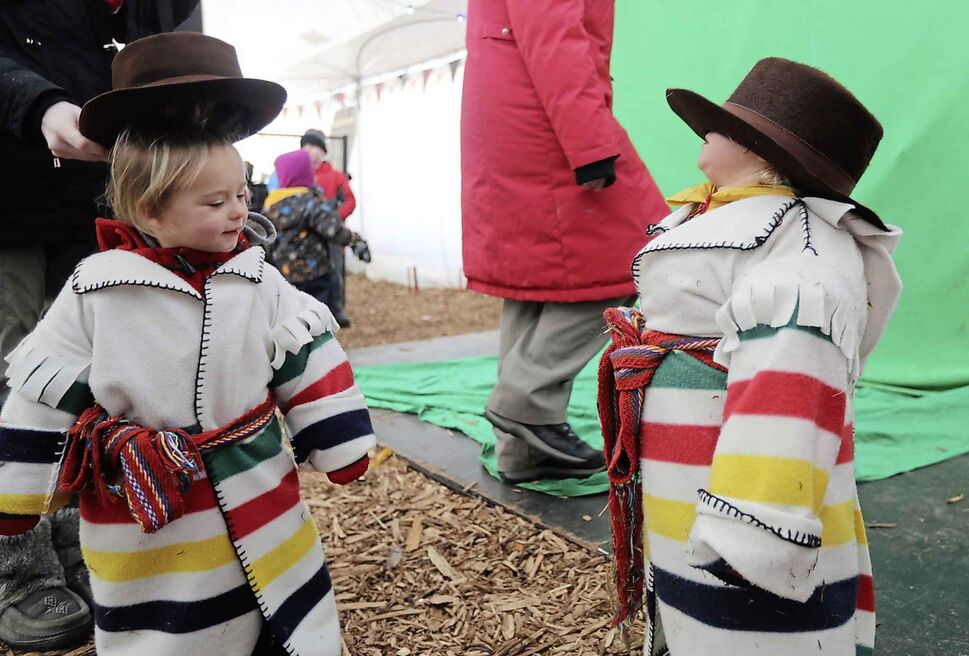 TREVOR HAGAN/ WINNIPEG PRESS Brothers, Zacharie and Ezechiel Janichon, 2, get dressed up for the last day of Festival du Voyageur on Feb. 24.