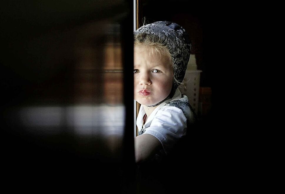 PHIL HOSSACK / WINNIPEG FREE PRESS</p><p>A young community member peers back at the camera at James Valley Hutterite Colony. One of the original Hutterite settlements in Manitoba, the James Valley community celebrates its 100th anniversary this year.</p>