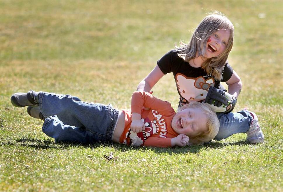 Five year old Ellowyn McNeill tickles her little brother Mannix, 3, while playing games and having a picnic with mom and dad at Assiniboine Park Saturday afternoon.  Mom says she was so happy to be able to do something with the kids outside after a rainy week.  March 31, 2012 (Ruth Bonneville/Winnipeg Free Press)