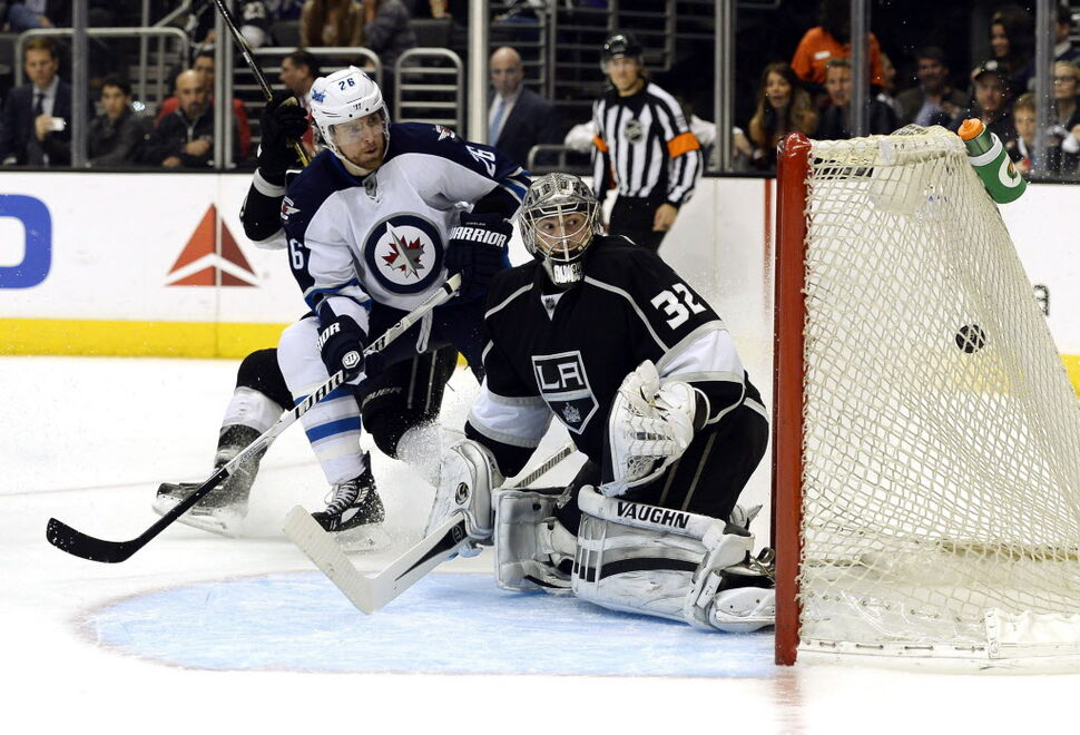 Winnipeg Jets right wing Blake Wheeler (26) scores a goal against Los Angeles Kings goalie Jonathan Quick (32) during the third period. (Kevork Djansezian / The Associated Press )