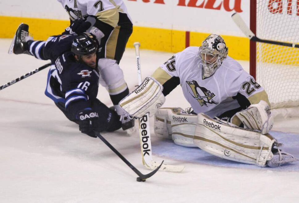 Winnipeg Jets' Andrew Ladd tries to get the puck past Pittsburgh Penguins goaltender Marc-Andre Fleury. Oct. 17, 2011 (BORIS MINKEVICH / WINNIPEG FREE PRESS)