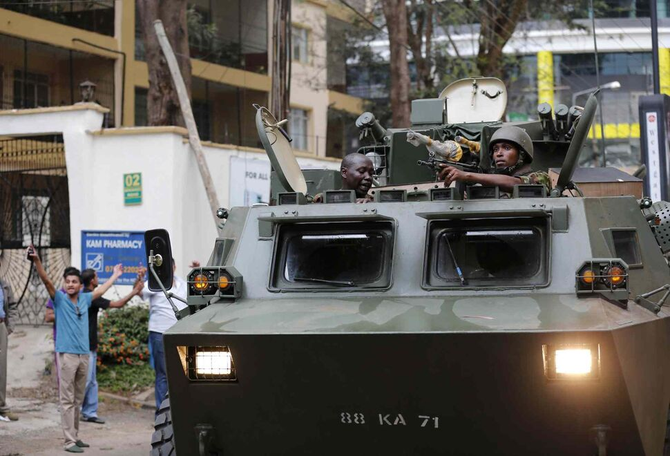 Soldiers arrive at Westgate Mall in Nairobi, Kenya on Saturday. A gun battle inside the shopping centre left at least 39 people dead after gunmen attacked one of the city's most exclusive malls.  (Zhang Chen / Xinhua / Tribune Media MCT)