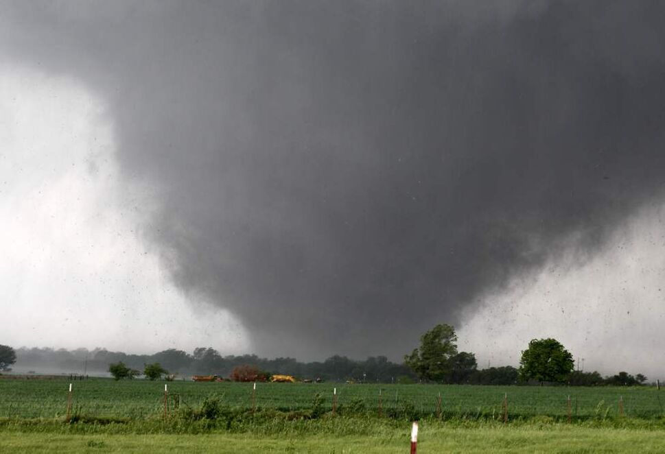 A tornado passes across south Oklahoma City, Monday. A monstrous tornado roared through the Oklahoma City suburbs, flattening entire neighborhoods with winds up to 320 km/h, setting buildings on fire and landing a direct blow on an elementary school.  (Paul Hellstern / The Associated Press)