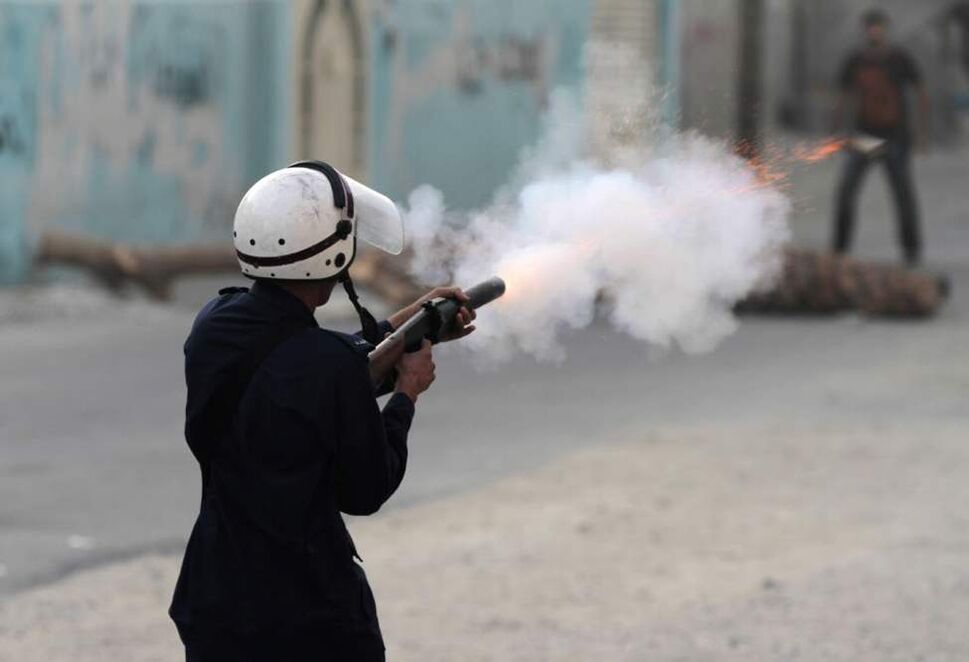 A riot policeman fires a tear gas canister toward anti-government protesters, in Diraz, Bahrain. Riot police used tear gas and stun grenades to disperse a demonstration against alleged deaths of infants and miscarriages blamed on excessive tear gas. (AP Photo/Hasan Jamali)