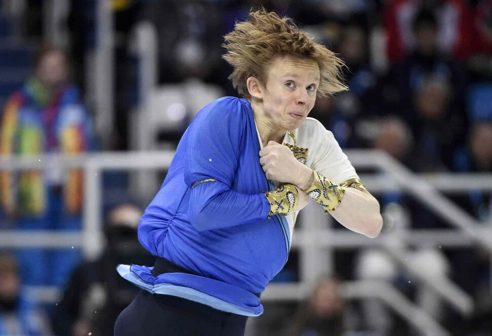 Canada's Kevin Reynolds performs his free program in the men's portion of the figure skating team event at the Sochi Winter Olympics Sunday. (Paul Chiasson / The Canadian Press)