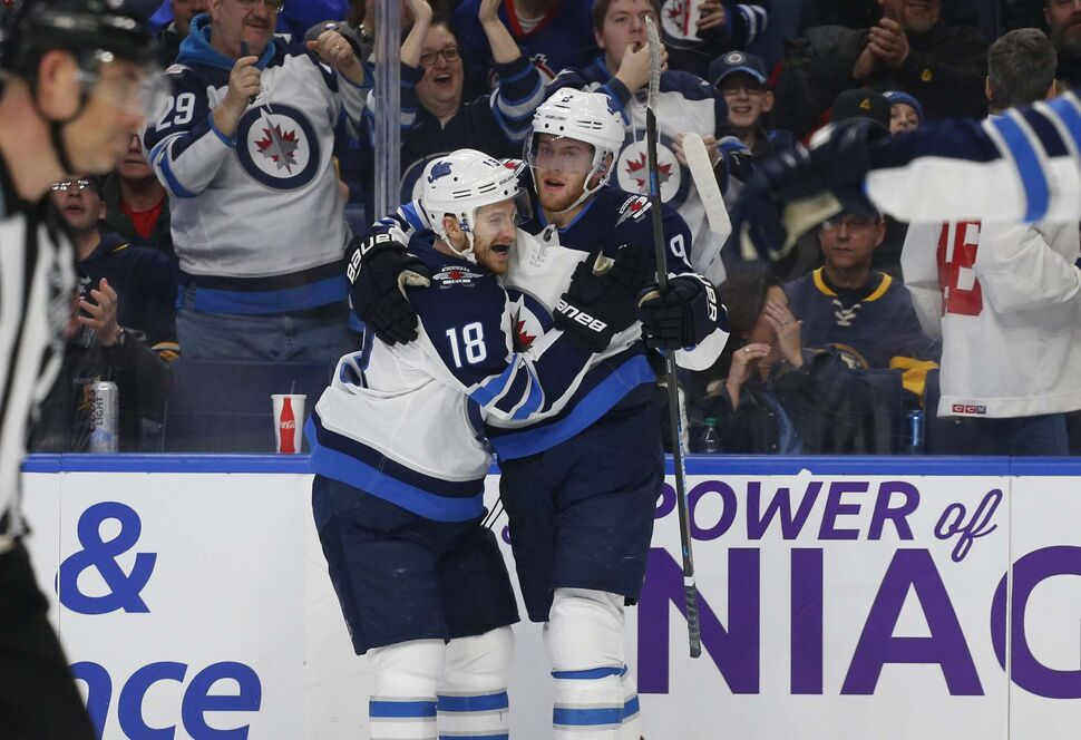 Winnipeg Jets Bryan Little (18) and Andrew Copp (9) celebrate a goal against the Buffalo Sabres Sunday. (Jeffrey T. Barnes / The Associated Press)