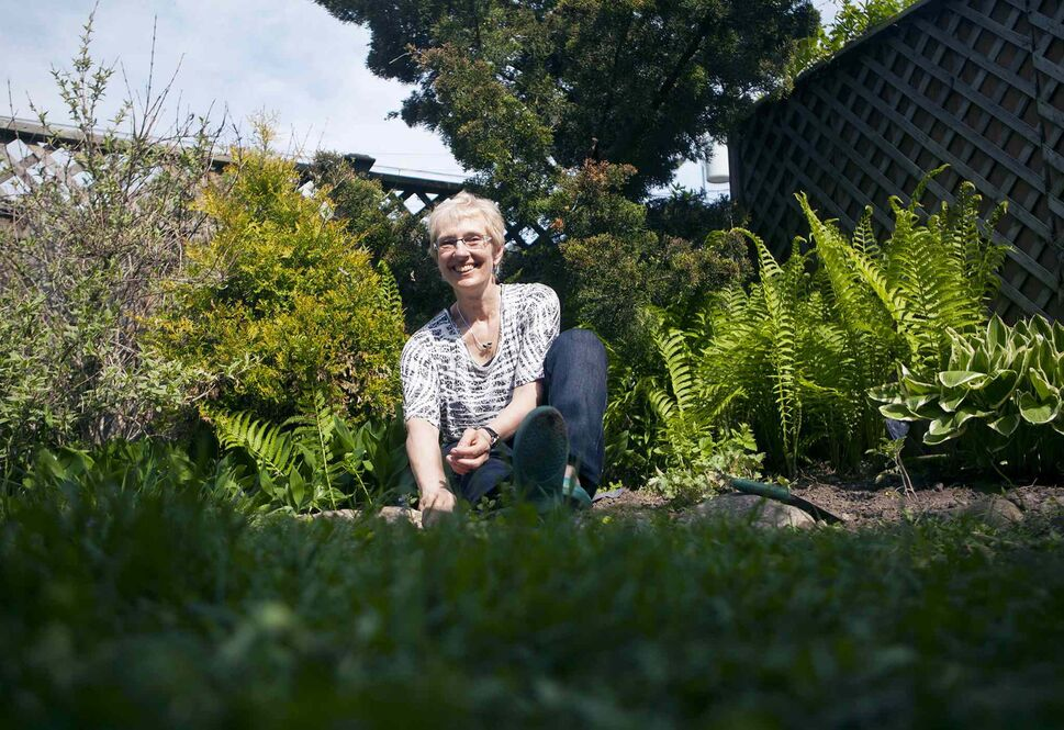 Eileen Boxall limits her gardening activity after suffering a lower-back injury last year. (Jesse Johnston / The Canadian Press)