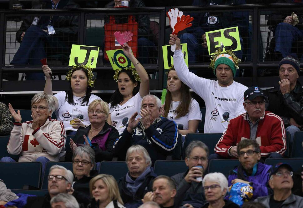 Fans cheer on Jennifer Jones and her squad. (Jason Halstead / Winnipeg Free Press)