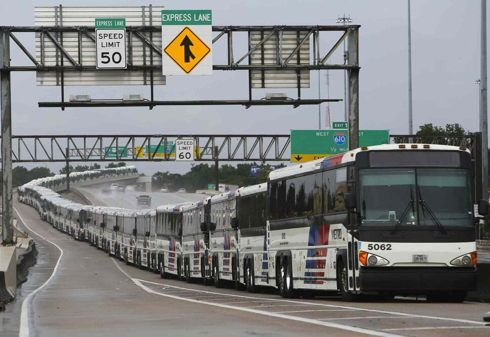 As a preventative measure, empty Metro buses are lined up in the centre lanes of Interstate 59 near Cavalcade in case their bus shelters flood, Saturday, Aug. 26, 2017, in Houston.  (Mark Mulligan / Houston Chronicle)