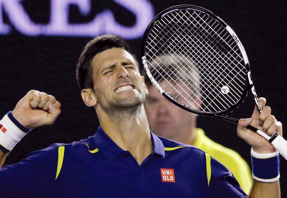 Novak Djokovic of Serbia celebrates after defeating Roger Federer of Switzerland in their semifinal match at the Australian Open tennis championships in Melbourne, Australia, Thursday. (Aaron Favila / The Associated Press)