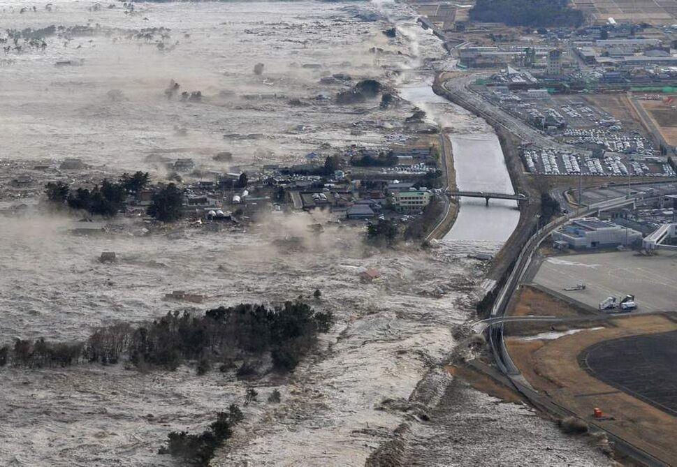 Earthquake-triggered tsumanis sweep shores along Iwanuma in northern Japan on Friday March 11, 2011. The magnitude 8.9 earthquake slammed Japan's eastern coast Friday, unleashing a 13-foot (4-meter) tsunami that swept boats, cars, buildings and tons of debris miles inland.  (AP Photo/Kyodo News)