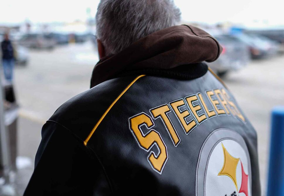His brother gave him this Pittsburg Steelers jacket just the day before, Tom's favorite sporting teams are the Steelers and the Boston Bruins. Watching sports on TV is one of his favorite pastimes.