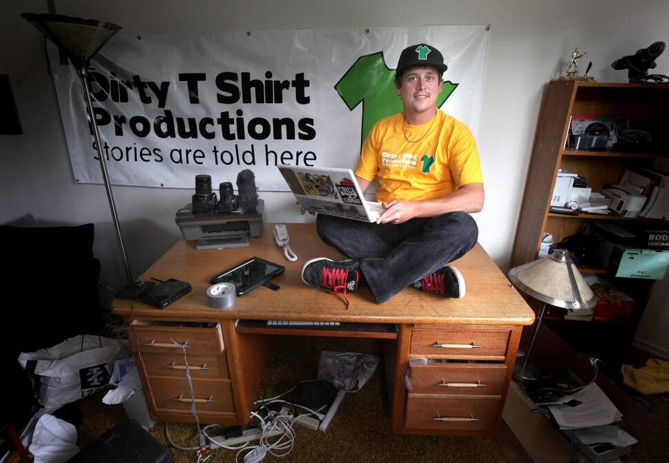 Steve Langston poses in his Osborne Village apartment that doubles as the offices of Dirty T Shirt Productions. June 12, 2012  (Phil Hossack / Winnipeg Free Press)
