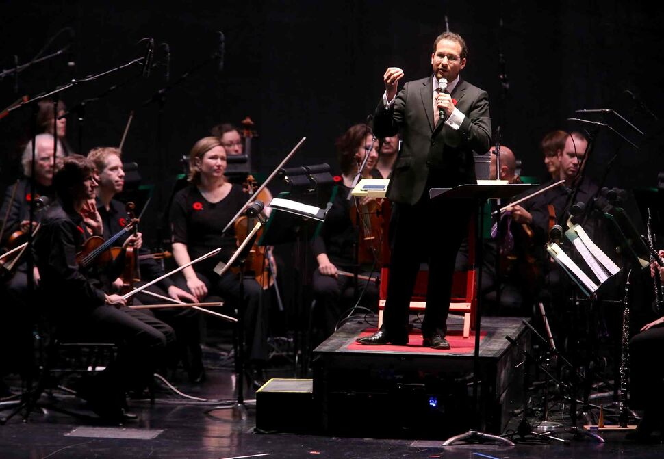 New resident conductor of the WSO Julian Pellicano (right) speaks to the audience at the start of the performance of Le Ombré Saturday. (TREVOR HAGAN / WINNIPEG FREE PRESS)
