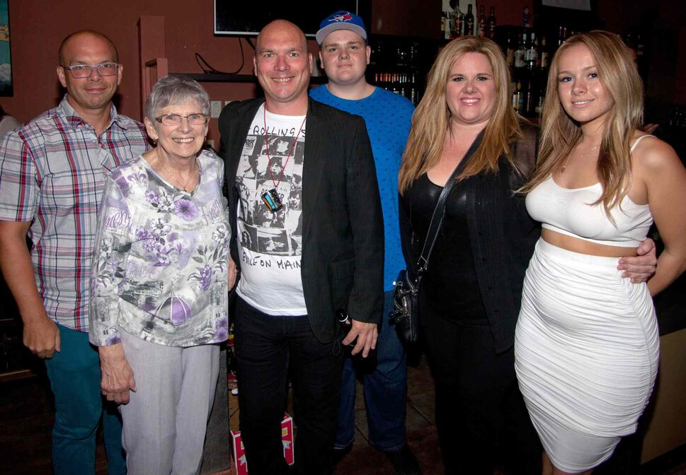 A surprise 50th birthday party for POP Sports & Entertainment's Dave Sherman was held Aug. 7, 2015 at Le Garage Café. Pictured, from left, are Peter Sherman, Ellen Sherman, Dave Sherman, Jordan Lamirande, Angie Lamirande and Brittney Lamirande. (JOHN JOHNSTON / WINNIPEG FREE PRESS)