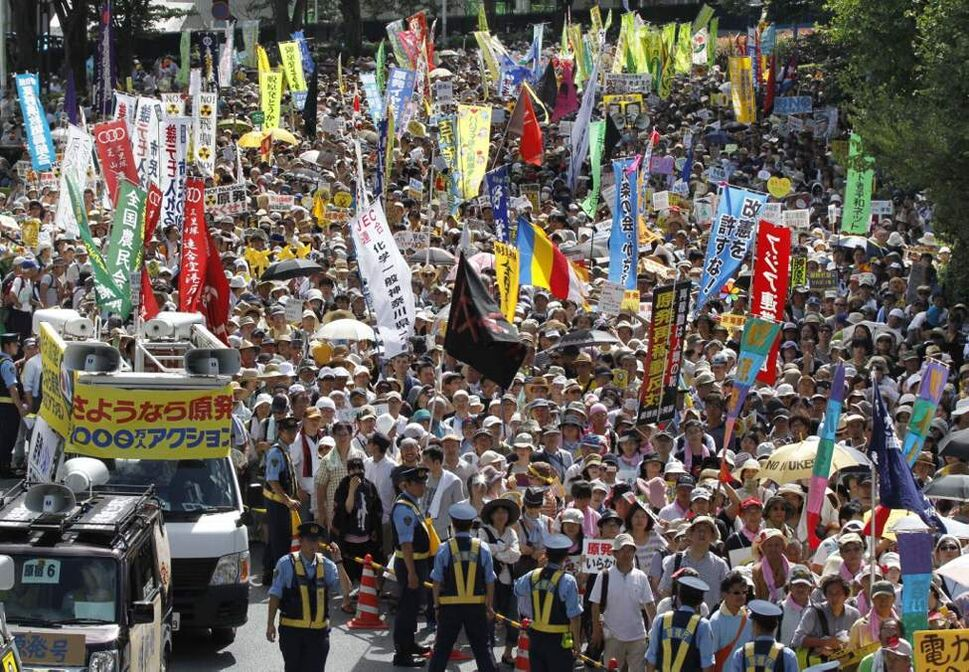 Tens of thousands of people gathered at a Tokyo park, demanding ;Sayonara,' or goodbye, to nuclear power as Japan prepares to restart yet another reactor, and expressed outrage over a report that blamed culture on the Fukushima disaster. (AP Photo/Koji Sasahara)