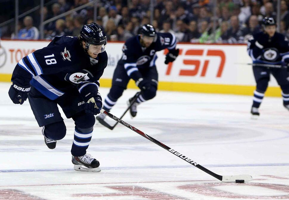Winnipeg Jets' Bryan Little skates into the Anaheim Ducks' zone on a breakaway during the second period. (TREVOR HAGAN / THE CANADIAN PRESS)