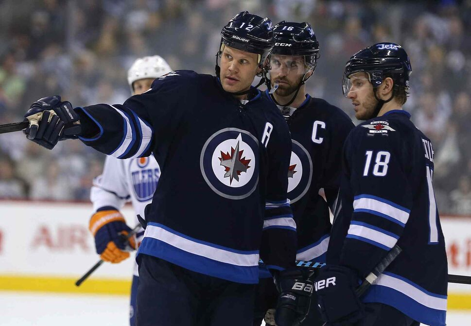 Winnipeg Jets' Olli Jokinen (12), Andrew Ladd (16) and Bryan Little (18) plan out the next play against the Edmonton Oilers during the game's second period Saturday at MTS Centre in Winnipeg. (Trevor Hagan / Winnipeg Free Press)
