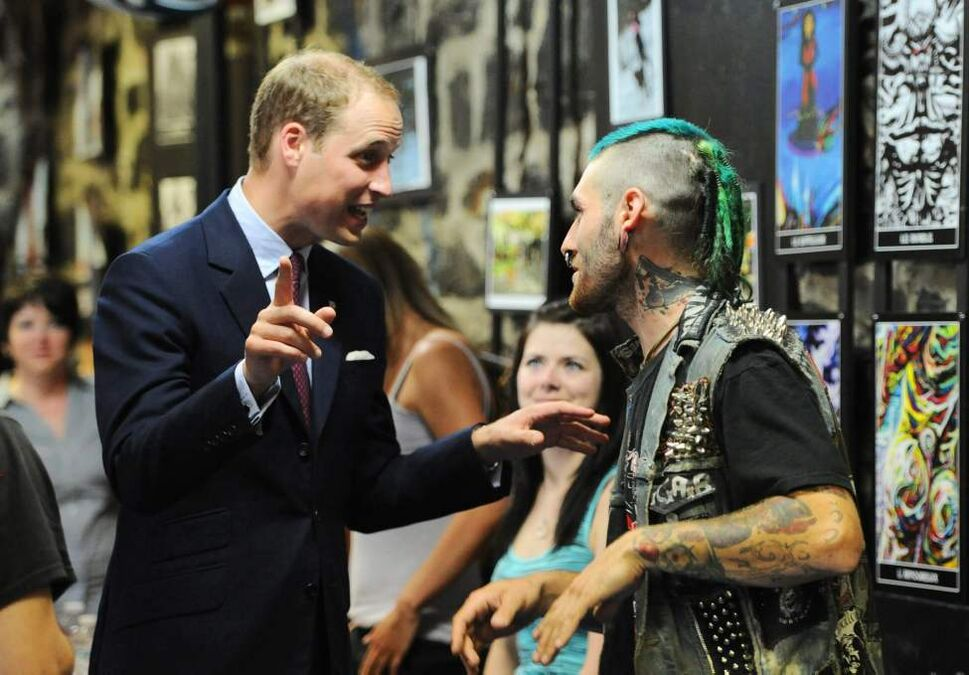 The Duke of Cambridge talks to a young man as he and the and the Duchess visit Maison Dauphine in visit Quebec City on Sunday, July 3, 2011. Maison Dauphine provides shelter and services to underprivileged children and families.  THE CANADIAN PRESS/Sean Kilpatrick