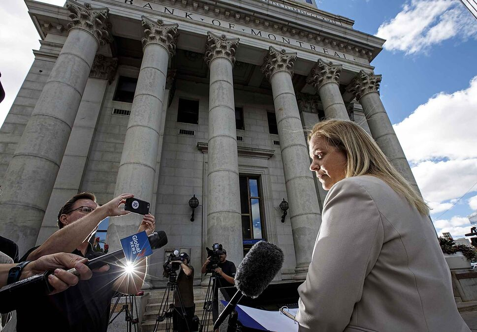MIKE DEAL / WINNIPEG FREE PRESS</p><p>July 17 — Jenny Motkaluk holds a press conference in front of the Bank of Montreal building at Portage and Main as part of her campaign against re-opening the intersection.</p>