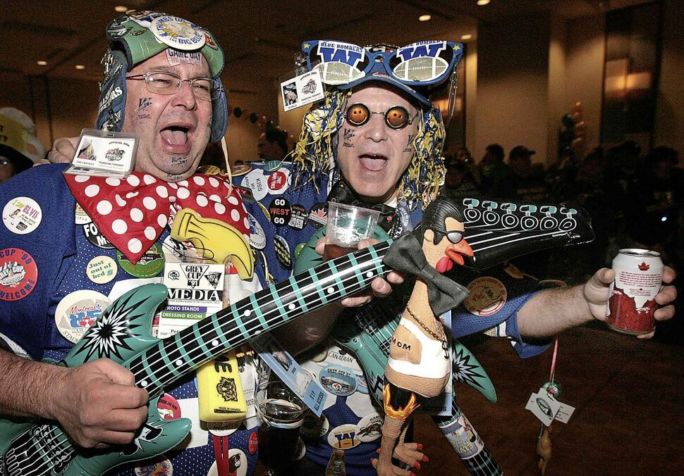 Winnipeg Blue Bombers fans including Cooch (left)  and Bubbles -- who call themselves the Transcona Terrorists -- arrive at a downtown Toronto hotel take in a Manitoba-themed social in 2007. (WINNIPEG FREE PRESS ARCHIVES)