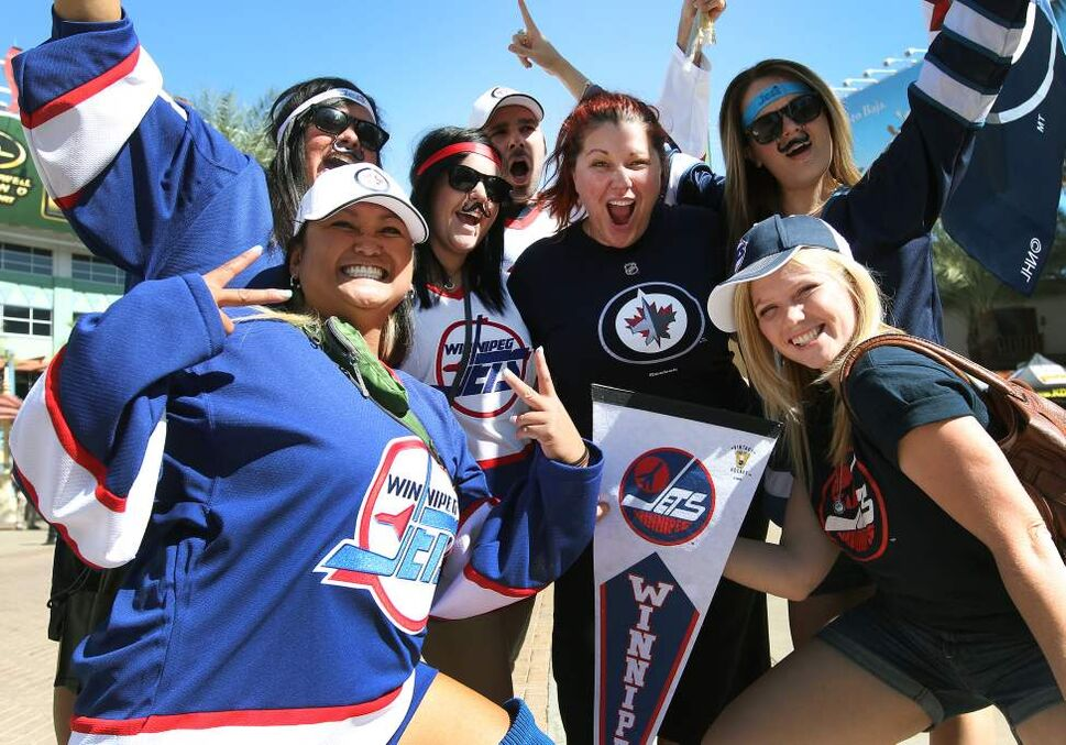 Winnipeg Jets fans from Winnipoeg go nuts outside the Jobing.com Arena in Phoenix, Arizona  Saturday prior to the start of the NHL game between the Winnipeg Jets and the Phoenix Coyotes.   (JOE BRYKSA / WINNIPEG FREE PRESS)