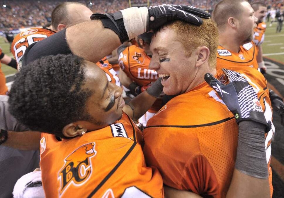 B.C. Lions quarterback Travis Lulay right,  is congratulated by teammates after winning 34-23 against the Winnipeg Blue Bombers during the 99th CFL Grey Cup Sunday. (THE CANADIAN PRESS/Nathan Denette)